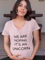 We are hoping it's an unicorn, nosečniška majica
