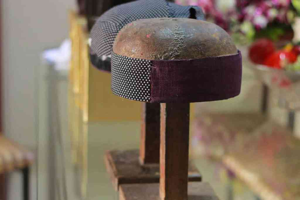 Gulshan Kolah, Black parsi paghadi, black cotton fabric with white dots, wooden head stand (made to measure), process of making a paghadi, photo: dolly bhavsar photography