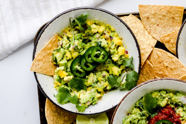 spicy mango guacamole in a white bowl