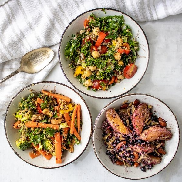 three bowls of quinoa salad