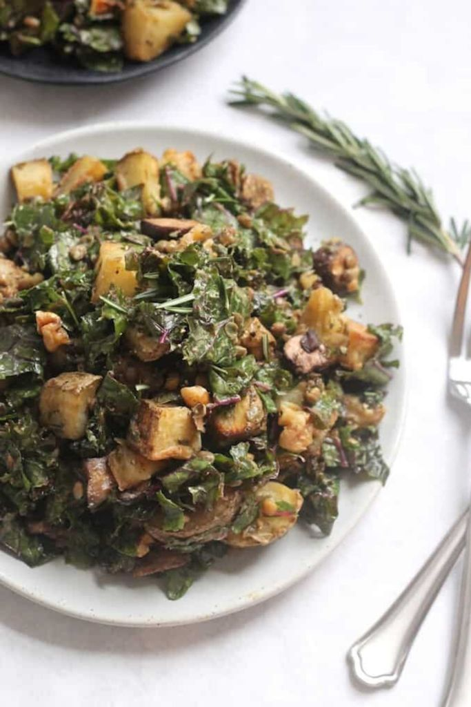 roasted potatoes in a kale salad