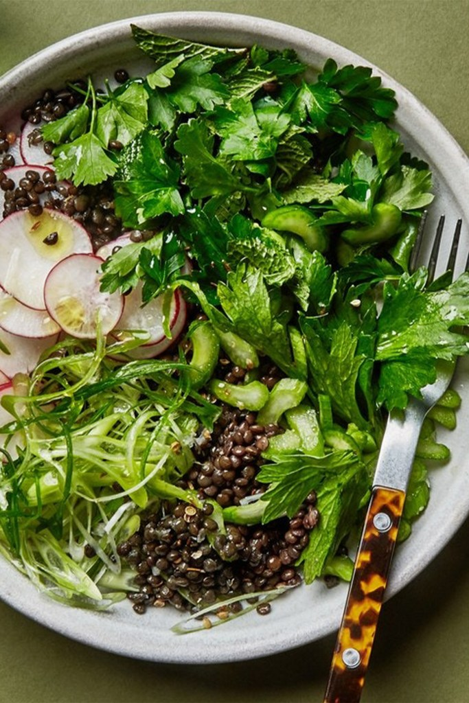 bowl with lentils and fresh green herbs