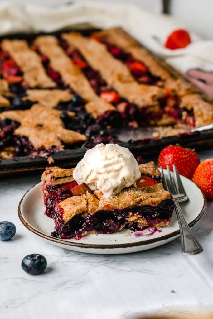 slice of american flag slab pie with vanilla ice cream