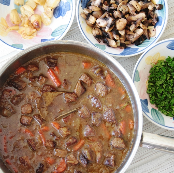 garlic beef stew with ingredients on the side