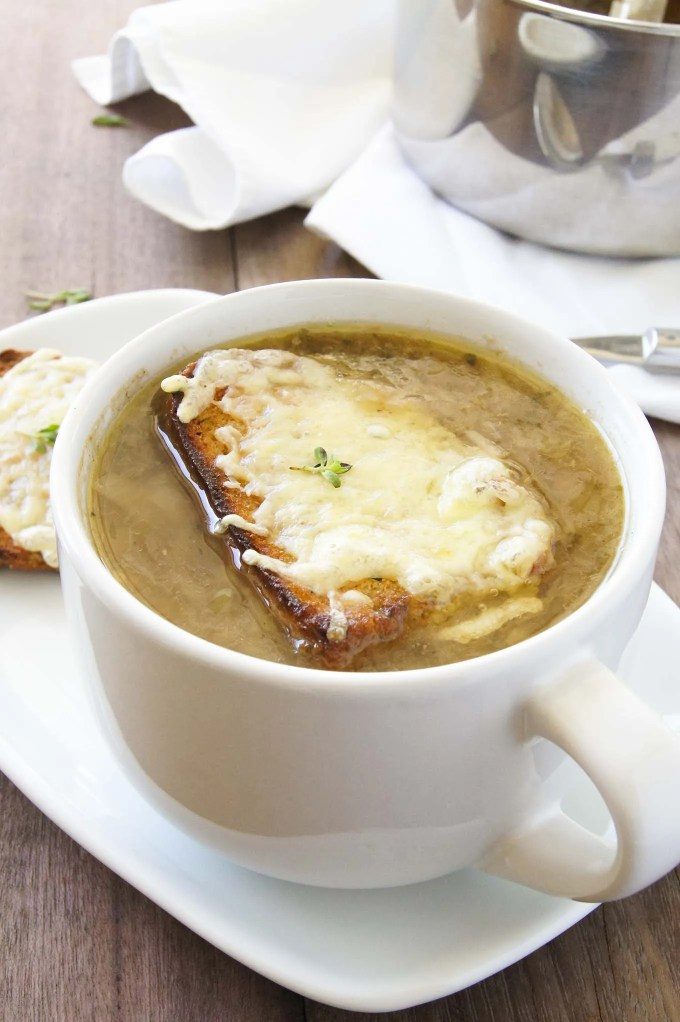 This easy and delicious Classic French Onion Soup recipe with Cheesy Croutes is a perfect comfort, country style soup for any weeknight in.