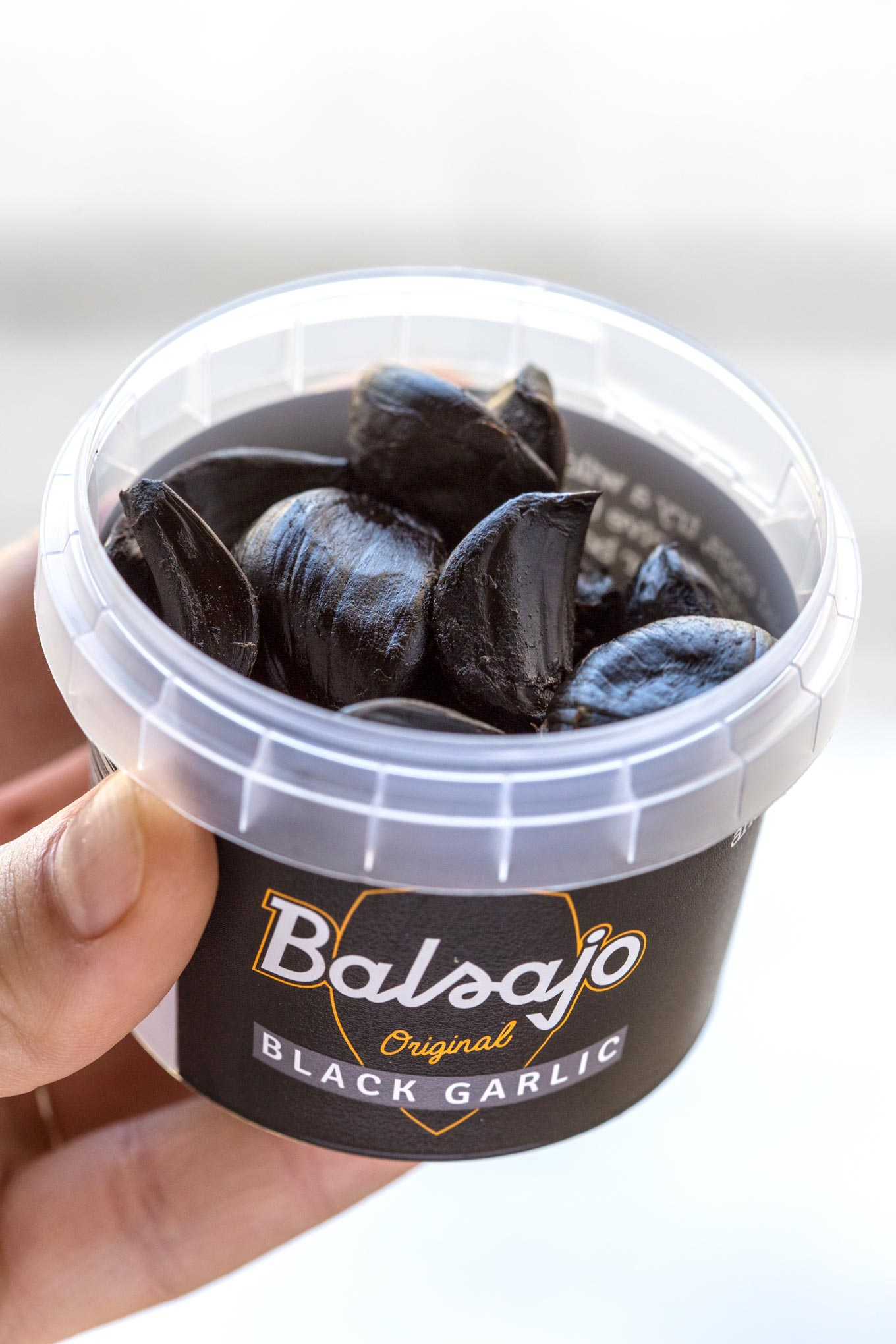 Balsajo Black Garlic Cloves in a small tube