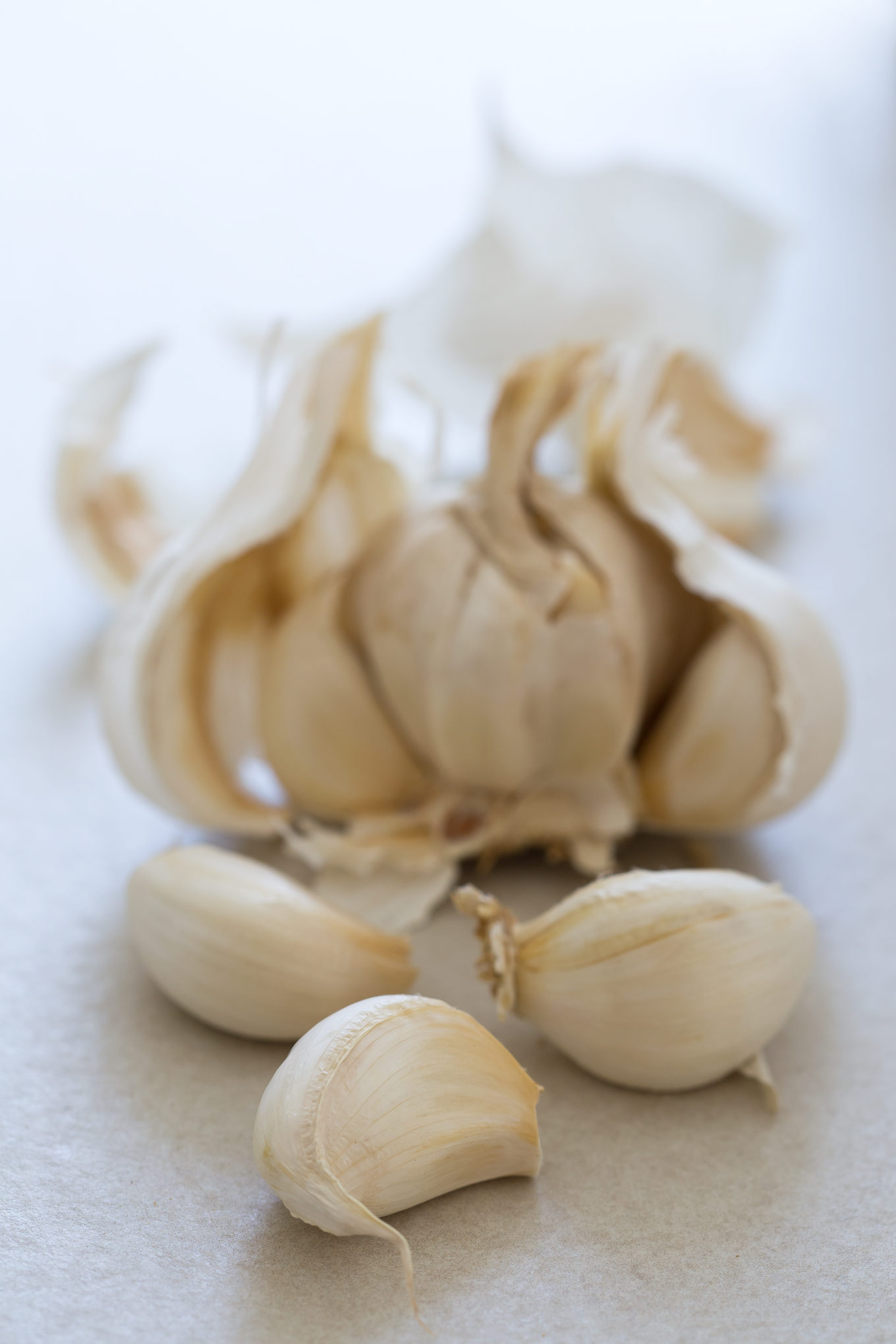 Garlic Cloves broken away from a whole head of garlic