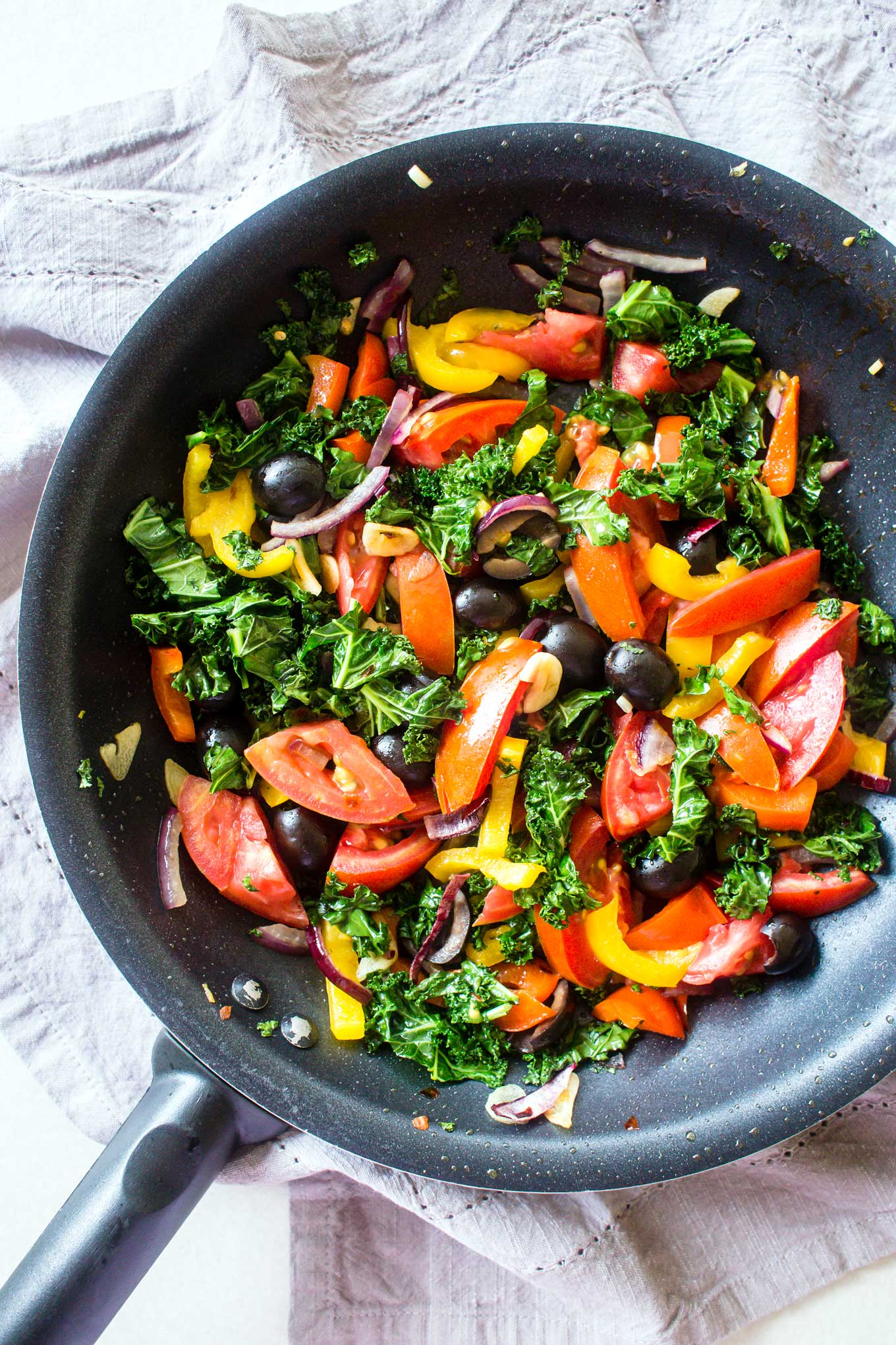 Bell Peppers, Olives, Tomatoes, Red Onions, Kale and Garlic in a pan