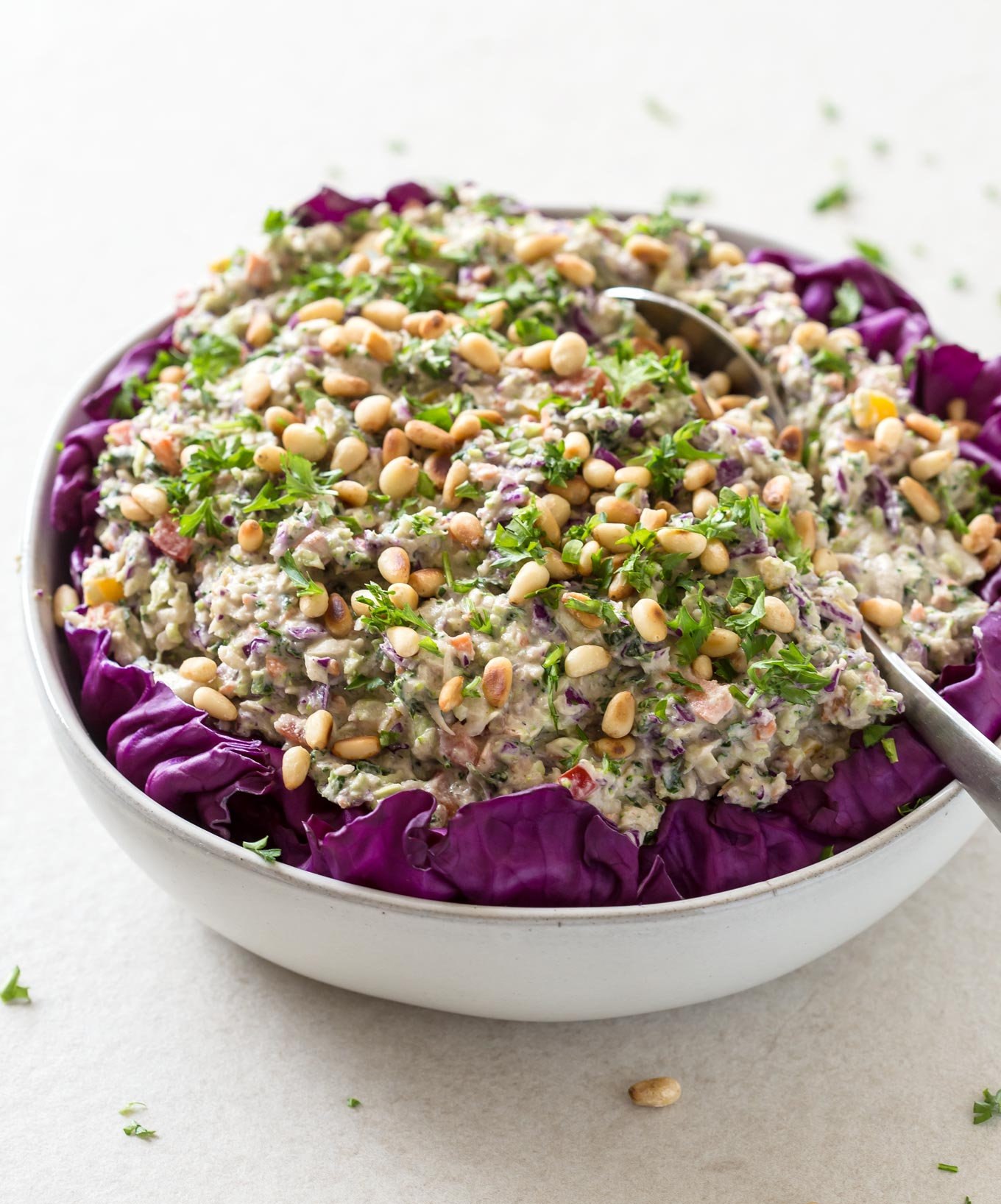 Rainbow Coleslaw Salad With Cashew Mayo in a serving bowl