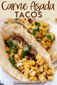 carne asada tacos topped with Mexican street corn salad
