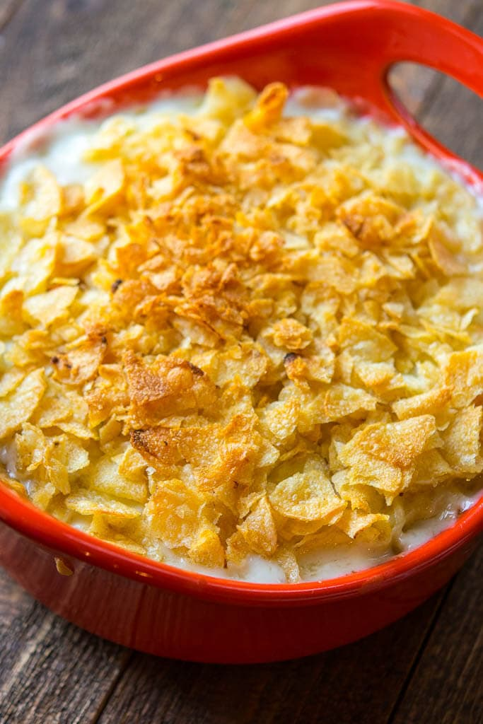 White Cheddar Beer Mac & Cheese in a round red casserole dish