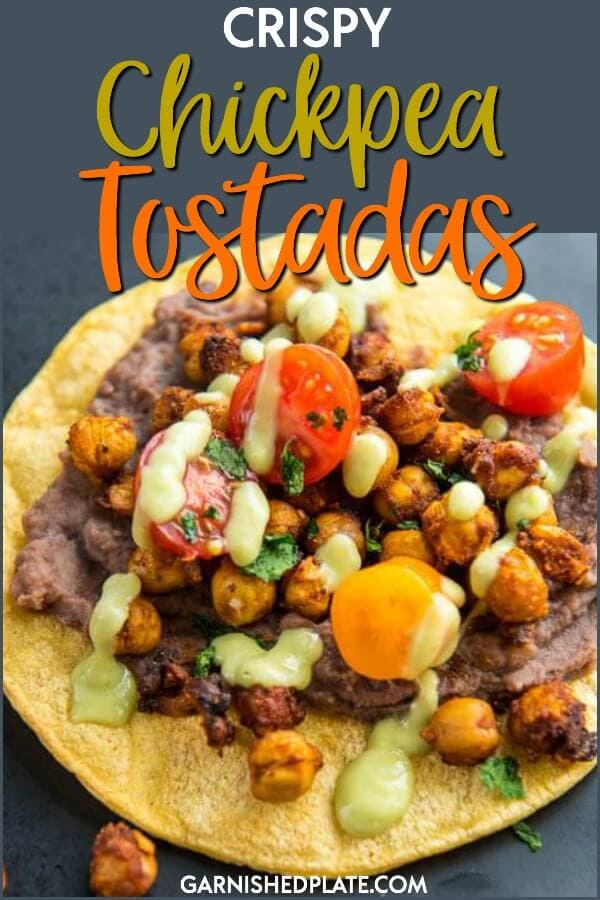Perfect for Meatless Monday or any other day of the week, these Crispy Chickpea Tostadas are delicious and filling! #garnishedplate #crispychickpea #chickpea #tostadas #refriedblackbeans #limejuice #avocado #tacoseasoning
