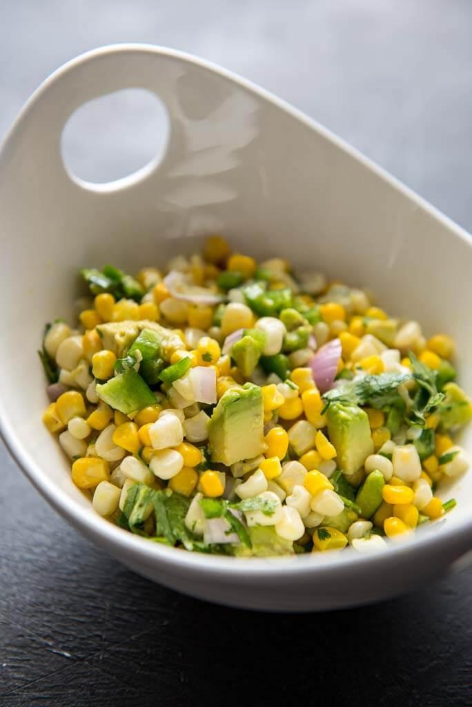 avocado corn salsa in white bowl