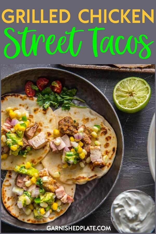 Want a meal that's sure to please a crowd or your family? How about these super simple Grilled Chicken Street Tacos! Garnish with Avocado Corn Salsa for a real treat! #garnishedplate #chickenthighs #tacos #streettacos #chickentacos