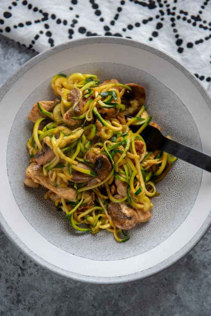 pork lo mein with zucchini noodles in bowl