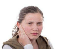young girl has earaches