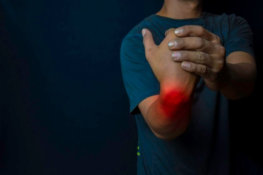 Young man suffering pain weakness and tingling in wrist.