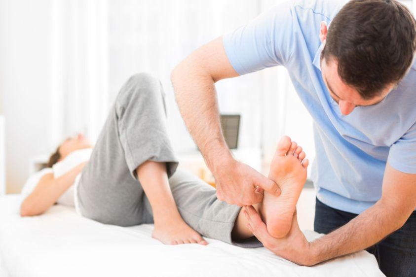 reflexology on a patient feet