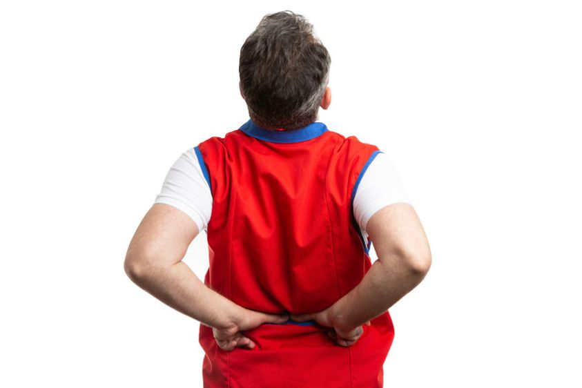 a man with back pain, cracking his back