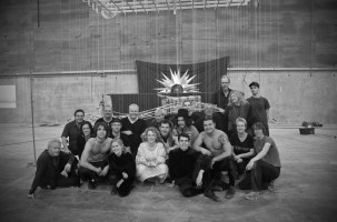 Cast and crew with the rising mechanical sun