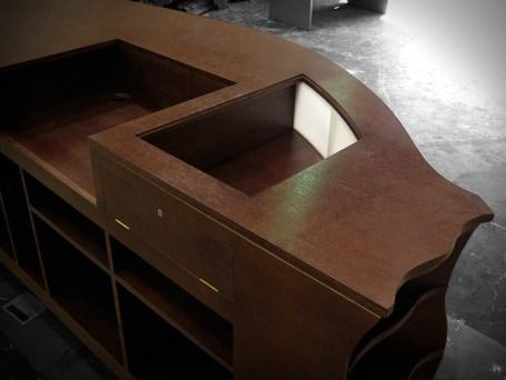 A hardwood CNC cut and assembled cash desk counter