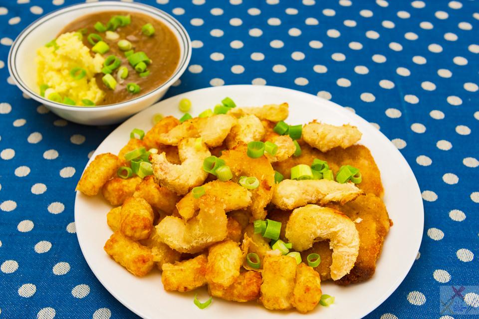 Chicken thigh schnitzel, potato gems and panko prawns with mashed potato and gravy Gary Lum