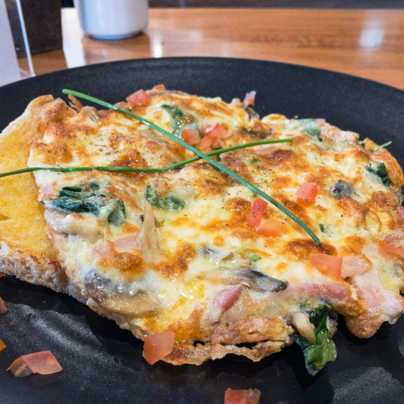 Julie-Anna's omelette with cheese, bacon, red onion, mushroom and spinach Gary Lum