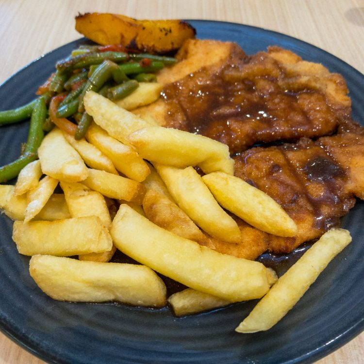 Chicken schnitzel with chips with gravy food blogging