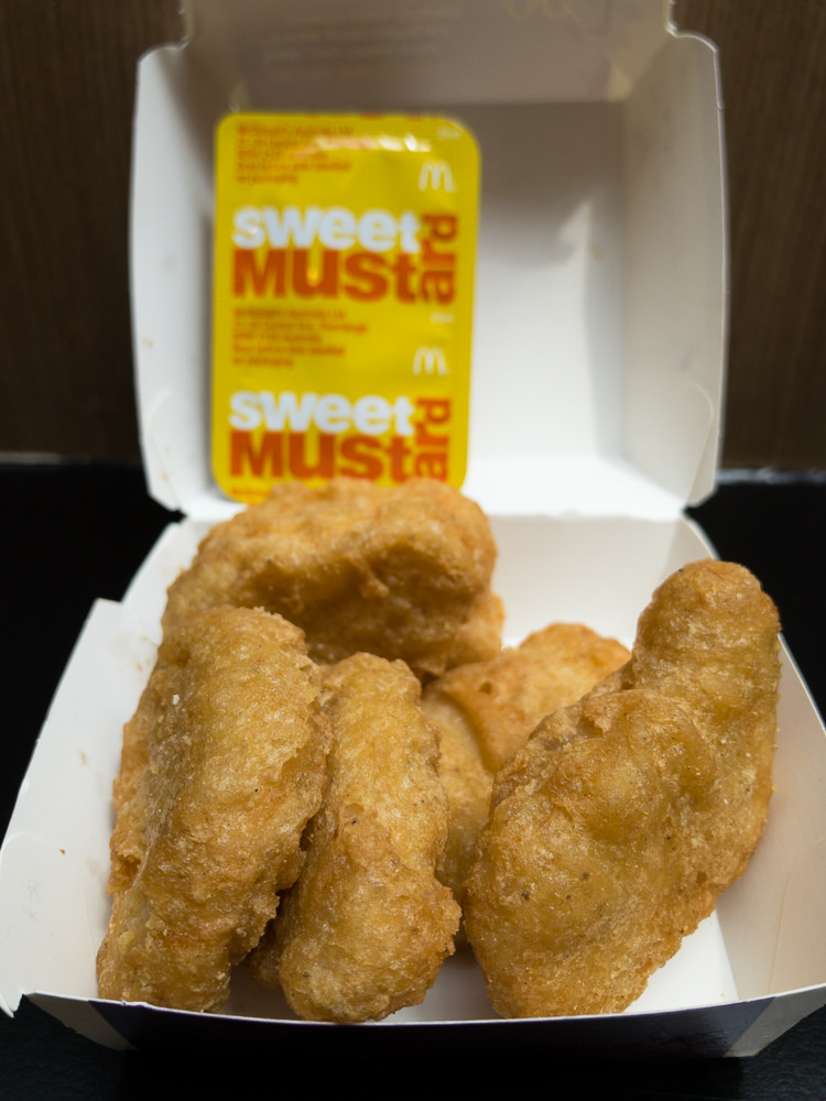 This is a photograph of Saturday lunch. Nugs and mustard from Maccas.
