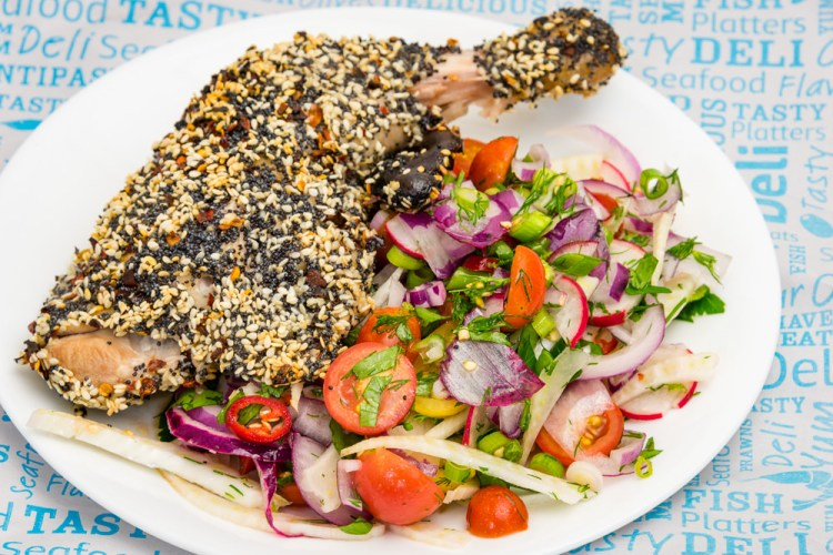 This is a photograph of Tuesday dinner. Poppy and sesame seed crusted Chicken Maryland with fennel and tomato lime salad. It's really colourful.