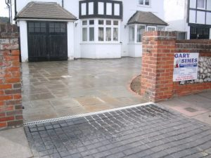 Residential indian stone driveway with brick edging