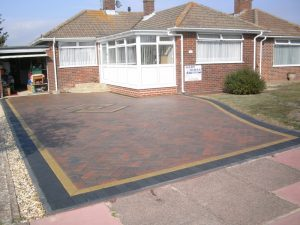 Standard Driveline 50 Driveway in Burnt Ochre with Charcoal Buff Border by Gary Simes in East Sussex