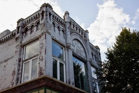 Whitewashed brick building in Cedar Rapids