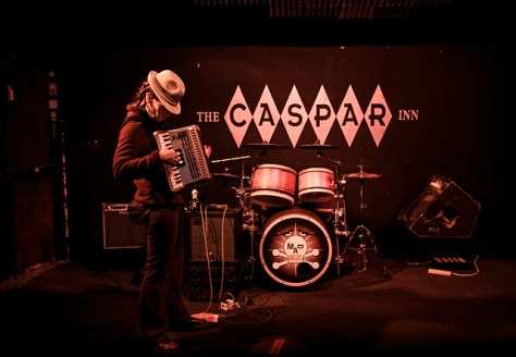 Mad Mags checks her squeezebox pre-show