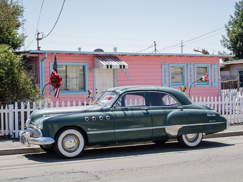 Old car in front of a pink house in Santa Rosa, CA