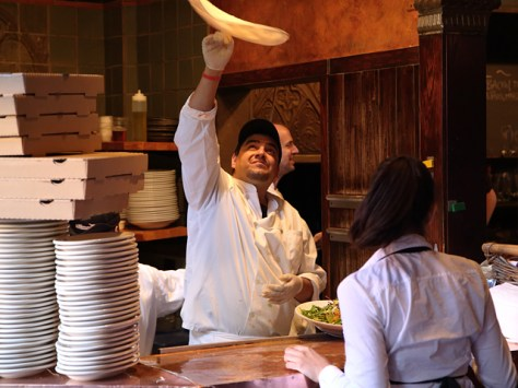 Pizza maker tossing the dough