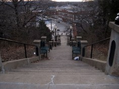 The stairs leading down from government building on the hill goes into the main downtown.