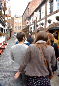 Belfast food tour group walking streets gastrogays behind