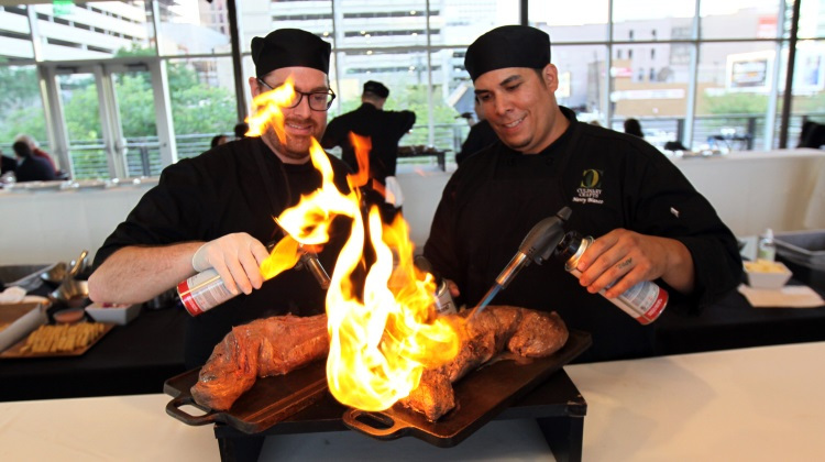 Culinary Crafts team torching beef tenderloin