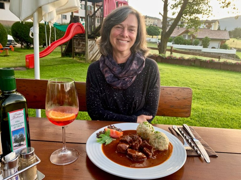 A hearty meal outside near Castelrotto