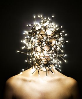 womans-head-wrapped-in-fairy-lights.jpg