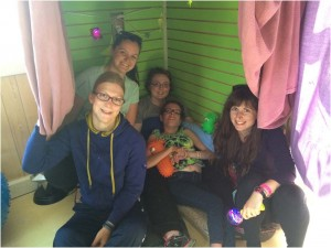 OT students Katie Johnston (top left) and Gina Hargreaves (bottom right) with campers in the Sensory Shed at Easter Seals Camp Horizon.
