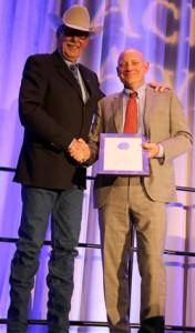 Rick Smith received the 2014 Lifetime Distinguished Achievement Award from MRU President David Docherty. ~ Photo by Michelle Bodnar