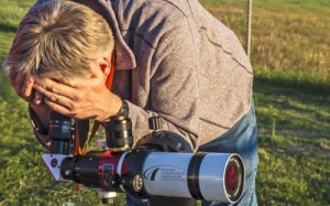 Professor Jeroen Stil looking at the sun through a solar viewing telescope. He teaches an introductory astronomy class and will be taking students outside Thursday afternoon to get a glimpse of the partial solar eclipse. Photo courtesy Alan Dyer, AmazingSky.net