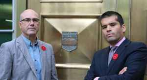Marco Civitarese, Chief Building Official for The City of Calgary, and Ola Malik, Municipal Prosecutor, stand outside the Provincial Court House, following a historic ruling for public safety.