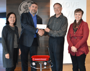 GE presents RiverWatch with cheque to fund science equipment, Jan 21. (L-R): Judy Eng-Hum, Alberta's Promise; James Cleland, GE; Cal Kullman, RiverWatch Institute of Alberta; Cheryl Dalwood, Alberta's Promise.