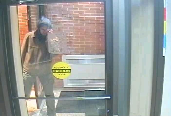 Suspect entering vestibule