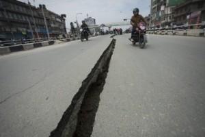 A crack in a road near Kathmandu caused by the April 25 earthquake. Photo credit: EPA/Hemanta Shrestha