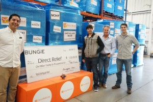 (From left to right) Santa Barbara-based Bungie gamers, Eddie Moreno, Raul Aguirre, and Ian Clark present the check for more than $1 million to Direct Relief CEO Thomas Tighe (second from right) to support the organization's Nepal earthquake response efforts. (PRNewsFoto/Direct Relief)