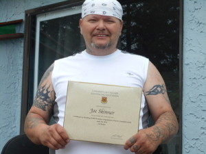 Joe Skinner proudly displays his WHP certificate. While he's faced many hardships in his life, Skinner is rising to the top thanks to some dedicated helping hands. Photo courtesy of Joe Skinner